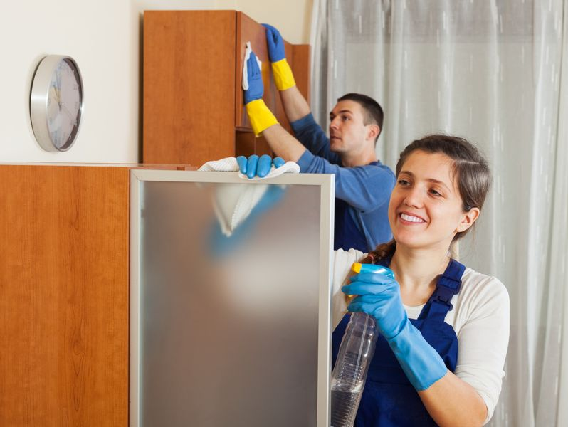 26110430 – professional cleaners team working at living room