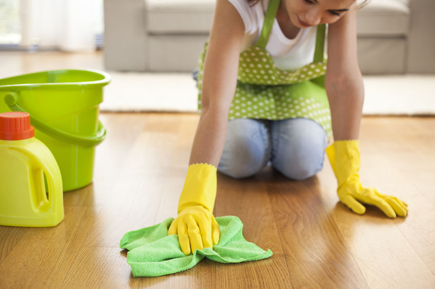 66121232 – woman with cloth cleaning floor in home